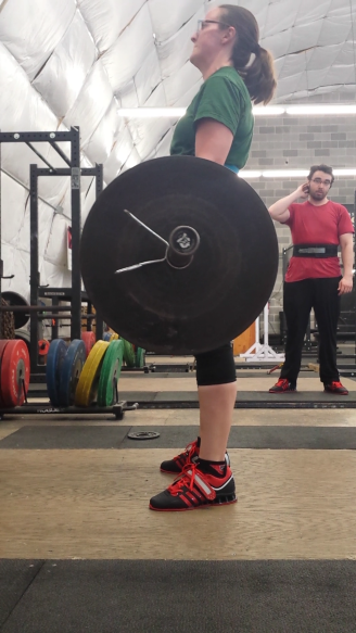Sara pulling 225lbs for 3 reps.